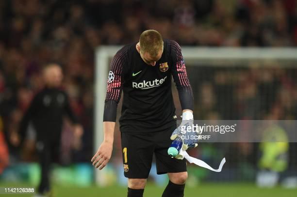 Barcelona's German goalkeeper Marc-Andre Ter Stegen reacts after losing the UEFA Champions league semi-final second leg football match between...