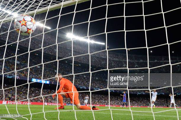 Barcelona's German goalkeeper Marc-Andre ter Stegen reacts after mu Bayern Munich's German forward Thomas Mueller scores a goal during the UEFA...