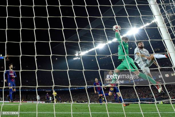 Barcelona's German goalkeeper MarcAndre Ter Stegen saves a shot on goal by Chelsea's French attacker Olivier Giroud during the UEFA Champions League...