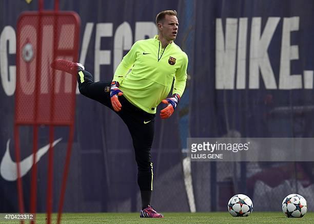 Barcelona's German goalkeeper Marc-Andre ter Stegen stretches during a training session at the Sports Center FC Barcelona Joan Gamper in Sant Joan...