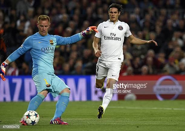 Barcelona's German goalkeeper Marc-Andre ter Stegen vies with Paris Saint-Germain's Uruguayan forward Edinson Cavani during the UEFA Champions League...