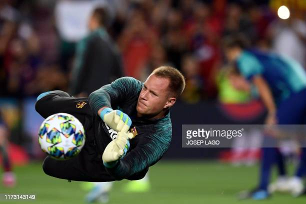 Barcelona's German goalkeeper Marc-Andre Ter Stegen warms up before the UEFA Champions League Group F football match between Barcelona and Inter...