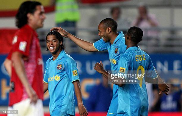 Barcelonas Giovani Thierry Henry and Samuel Etoo celebrate a goal during their Spanish League football match against Murcia at La Nueva Condomina...