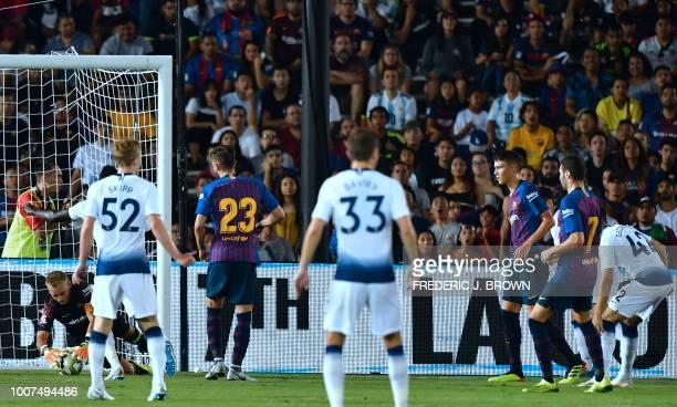 Barcelona's goalkeeper Jasper Cillessen saves a shot from Anthony Georgiou of Tottenham Hotspur during the International Champions Cup football match...