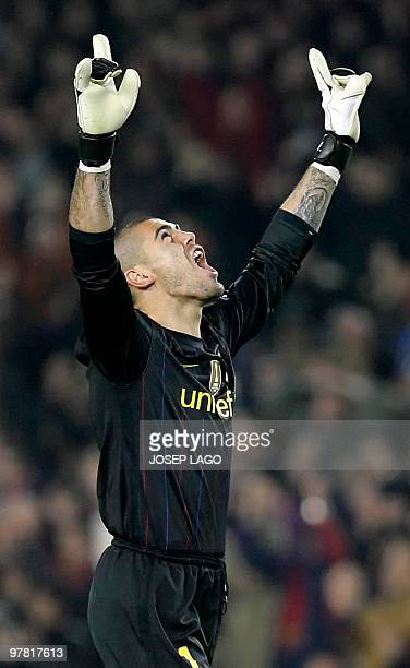 Barcelona's goalkeeper Victor Valdes celebrates after teammate Argentinian forward Lionel Messi scored Barcelona's third goal during the UEFA...