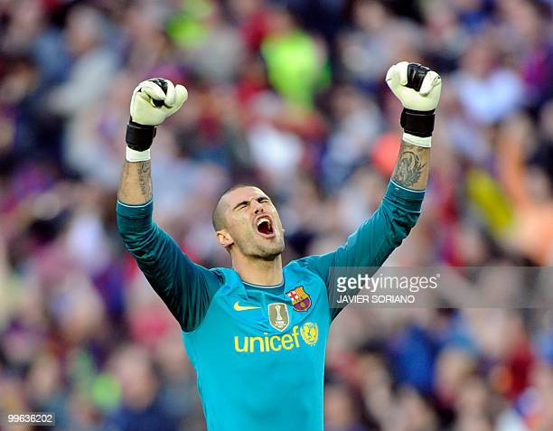 Barcelona's goalkeeper Victor Valdes celebrates after teammate Argentinian forward Lionel Messi scored during their Spanish League football match at...