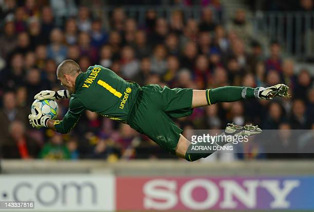 Barcelona's goalkeeper Victor Valdes dives for the ball during the UEFA Champions League second leg semifinal football match Barcelona against...