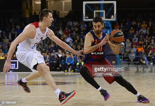 Barcelona's guard Juan Carlos Navarro vies with CSKA Moscow's Russian guard Vitaly Fridzon during the Euroleague group F top 16 round 10 basketball...