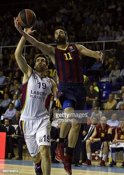 Barcelona's guard Juan Carlos Navarro vies with Laboral Kutxa's guard Fernando San Emeterio during the Euroleague basketball match FC Barcelona vs...