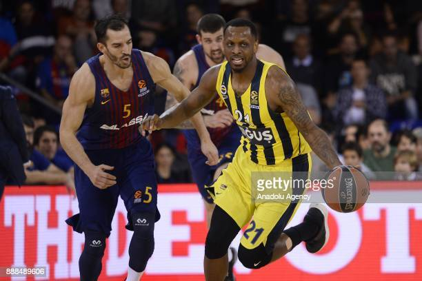 Barcelona's guard Pau Ribas in action against Fenerbahce Dogus Istanbul's US forward James Nunnally during the Turkish Airlines Euroleague basketball...
