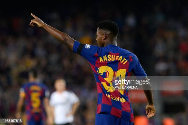 Barcelona´s Guinea-Bissau forward Ansu Fati celebrates after scoring a goal during the Spanish league football match FC Barcelona against Valencia CF...
