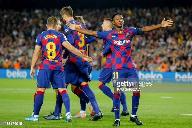 Barcelona´s GuineaBissau forward Ansu Fati celebrates after scoring a goal during the Spanish league football match FC Barcelona against Valencia CF...