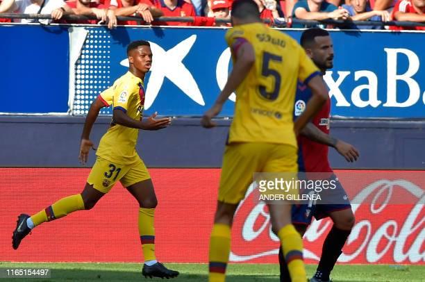 Barcelona´s GuineaBissau forward Ansu Fati celebrates after scoring during the Spanish league football match CA Osasuna against FC Barcelona at El...