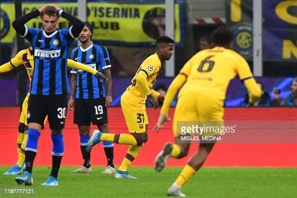 Barcelona´s GuineaBissau forward Ansu Fati celebrates after scoring during the UEFA Champions League Group F football match Inter Milan vs Barcelona...