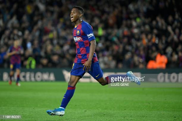 Barcelona's Guinea-Bissau forward Ansu Fati celebrates after scoring during the Spanish league football match be tween FC Barcelona and Levante UD at...