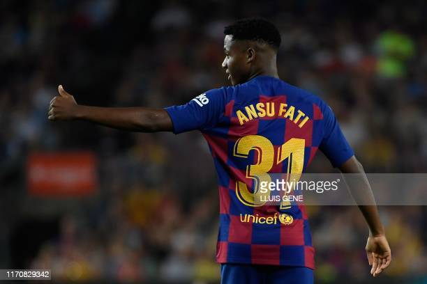 Barcelona´s GuineaBissau forward Ansu Fati gestures during the Spanish league football match between FC Barcelona and Villarreal CF at the Camp Nou...