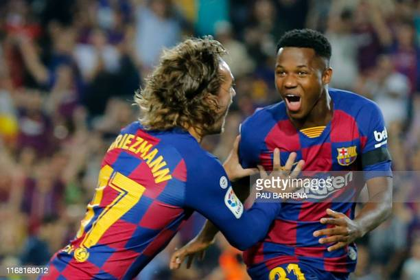 Barcelona´s GuineaBissau forward Ansu Fati is congratulated by Barcelona's French forward Antoine Griezmann after scoring a goal during the Spanish...