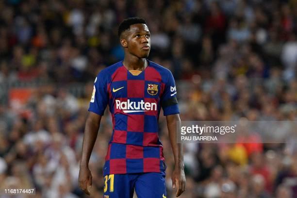Barcelona´s GuineaBissau forward Ansu Fati reacts during the Spanish league football match FC Barcelona against Valencia CF at the Camp Nou stadium...