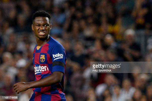 Barcelona´s GuineaBissau forward Ansu Fati reacts during the Spanish league football match FC Barcelona against Valencia CF at the Camp Nou stadium...