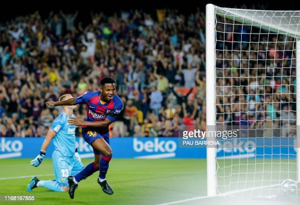 Barcelona´s Guinea-Bissau forward Ansu Fati scores the first goal during the Spanish league football match FC Barcelona against Valencia CF at the...