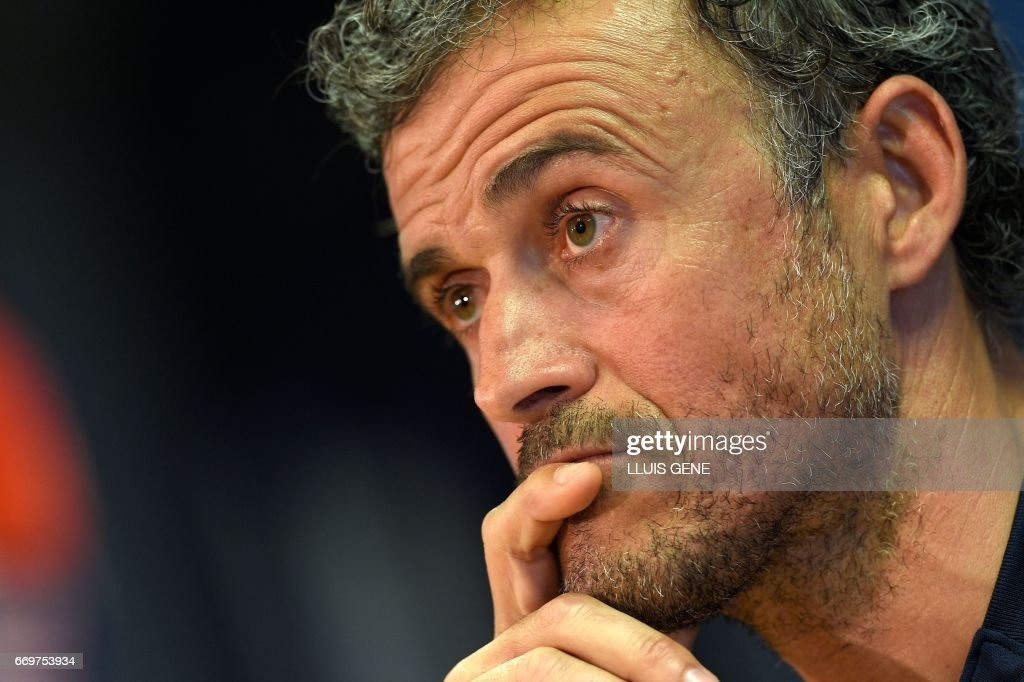 Barcelona's head coach Luis Enrique listens during a press conference at the Joan Gamper Sports Center in Sant Joan Despi, near Barcelona, on April 18, 2017 on the eve of the UEFA Champions League quarter-final second leg football match FC Barcelona vs Juventus. /