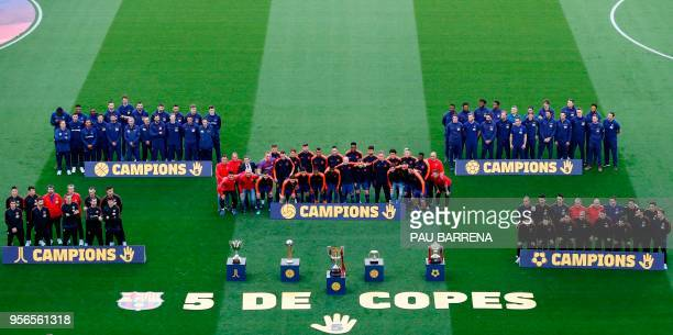 Barcelona's hockey, basketball, football, futsal and handball champions pose for a group picture behind their trophies ahead of the Spanish league...