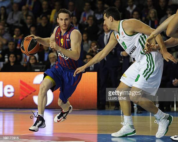 Barcelona's Italian guard Marcelinho Huertas vies with Panathinaikos' guard Dimitris Diamantidis during the Euroleague basketball match Regal FC...