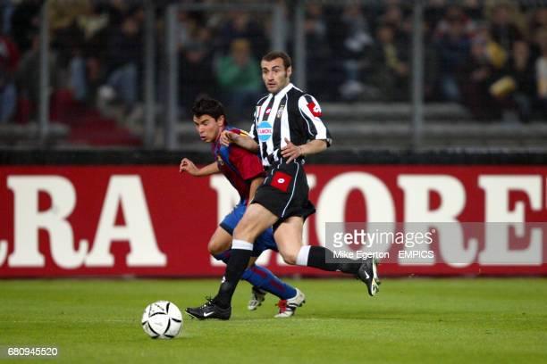 Barcelona's Javier Saviola tries to get past Juventus' Paolo Montero