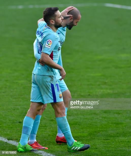 Barcelona's Jordi Alba celebrates scoring his team's second goal with teanmate Spanish defender Aleix Vidal during the Spanish league football match...