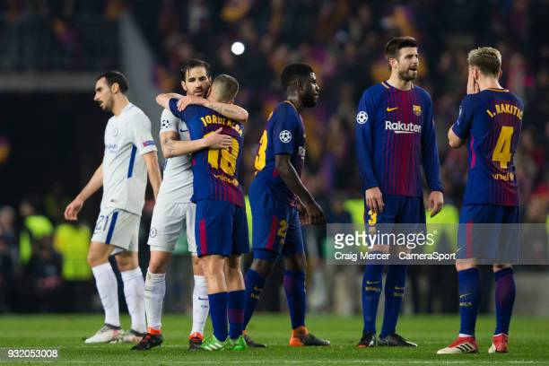 Barcelonas Jordi Alba hugs Chelsea's Cesc Fabregas at full time during the UEFA Champions League Round of 16 Second Leg match FC Barcelona and...