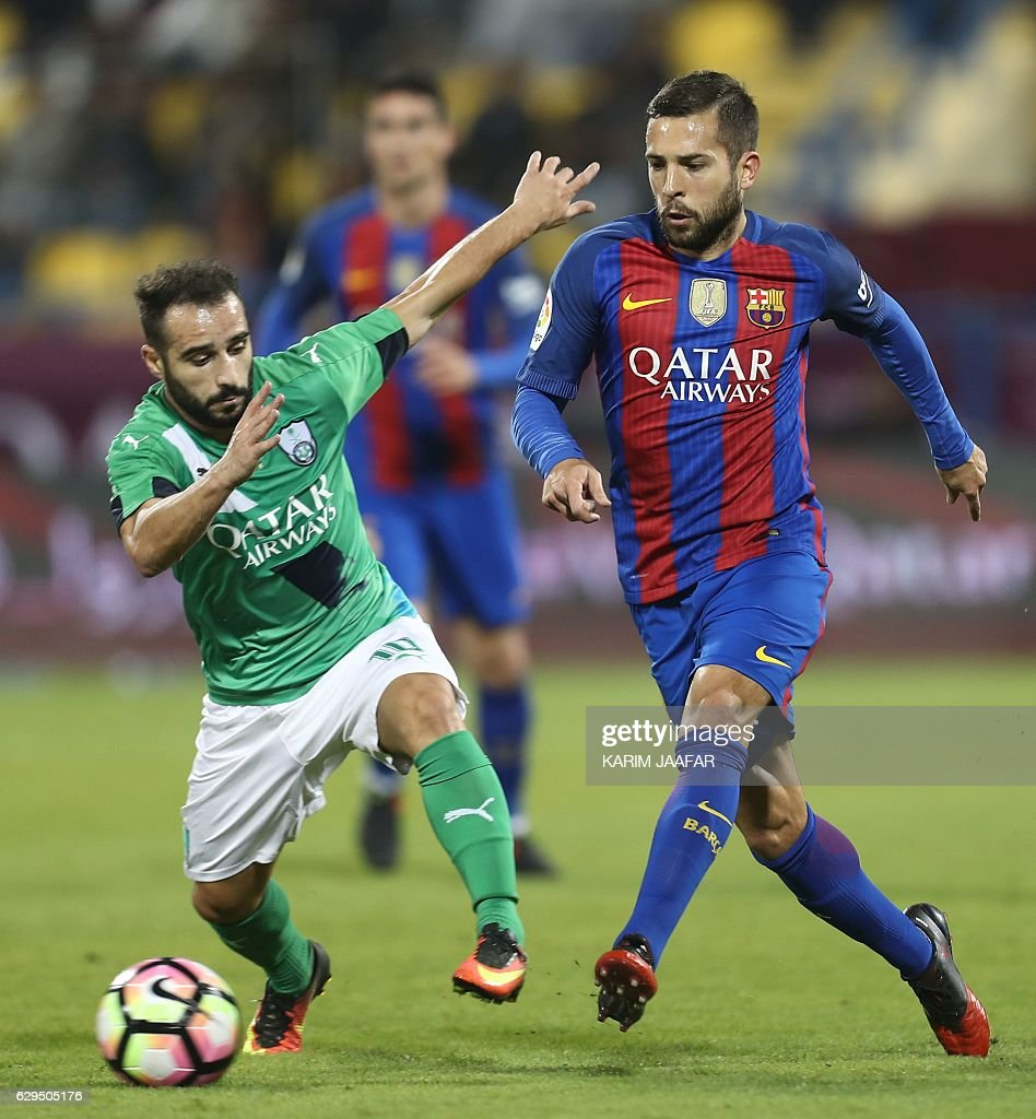 FC Barcelona's Jordi Alba vies for the ball with Al-Ahly's Giannis Fetfatzidis during a friendly football match between FC Barcelona and Saudi Arabia's Al-Ahli FC on December 13, 2016 in the Qatari capital Doha. Goals from Luiz Suarez, Lionel Messi and Neymar helped Barcelona beat Saudi champions Al-Ahli 5-3 in a thrilling friendly in Doha. The superstar trio all scored by the 17th minute, helping the Spanish giants to stroll into an early three-goal lead. JAAFAR