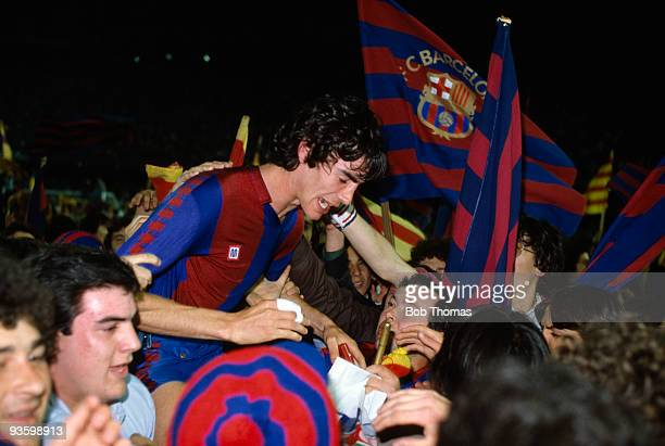 Barcelona's Jose Manuel Moratalla is carried from the field by jubilant supporters after their victory over Standard Liege in the European Cup...