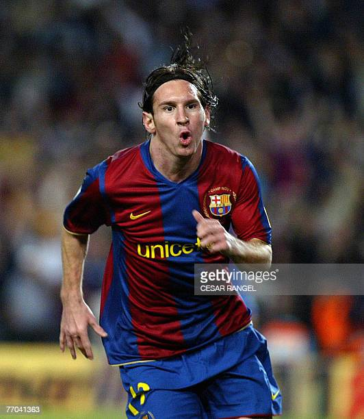 Barcelona's Leo Messi celebrates after scoring the second goal against Zaragoza during their Spanish League football match at the Camp Nou Stadium in...