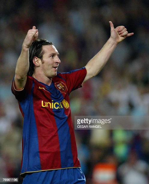 Barcelona's Leo Messi of Argentina celebrates after scoring the second goal against Sevilla during their Spanish League football match at the Camp...