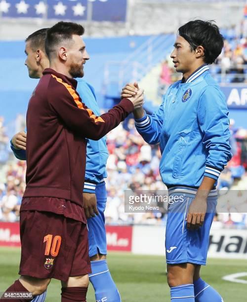 FC Barcelona's Lionel Messi and Getafe's Gaku Shibasaki shake hands before a Spanish La Liga soccer match in Getafe Spain on Sept 16 2017 Shibasaki...