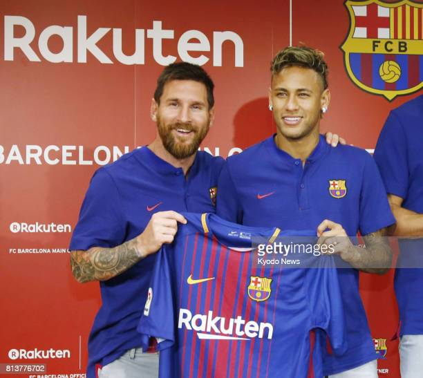 FC Barcelona's Lionel Messi and Neymar show off the team's shirt for the 20172018 season at Rakuten Inc's Tokyo headquarters on July 13 2017 The...