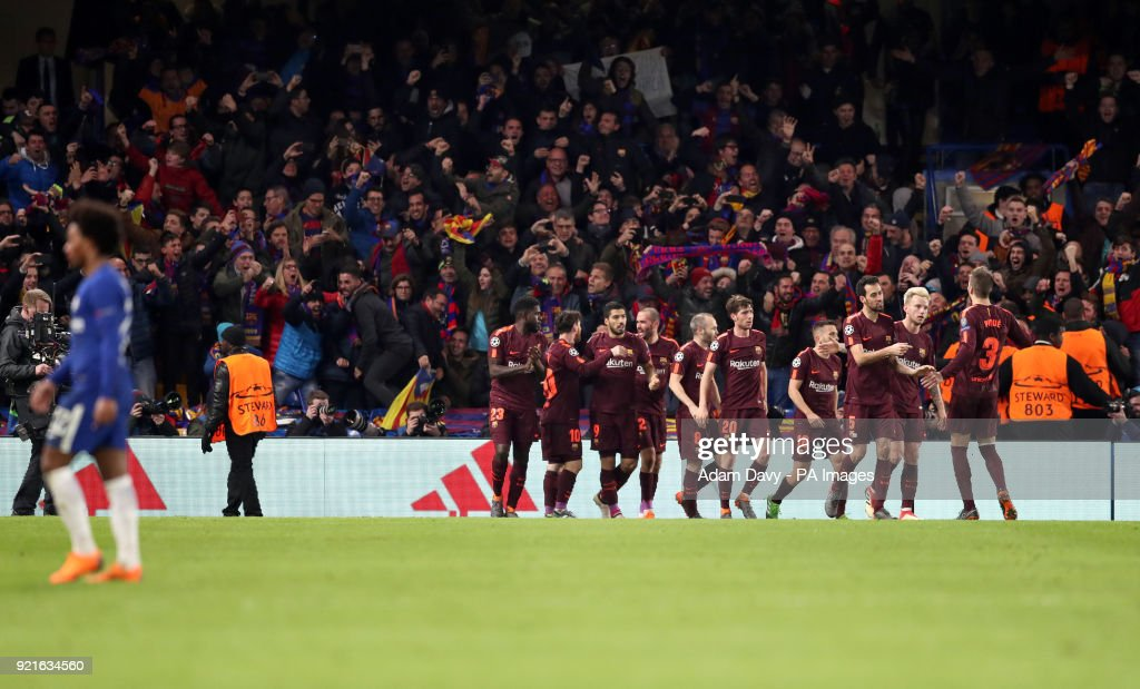 Barcelona's Lionel Messi (centre) celebrates scoring his side's first goal of the game during the UEFA Champions League round of sixteen, first leg match at Stamford Bridge, London.