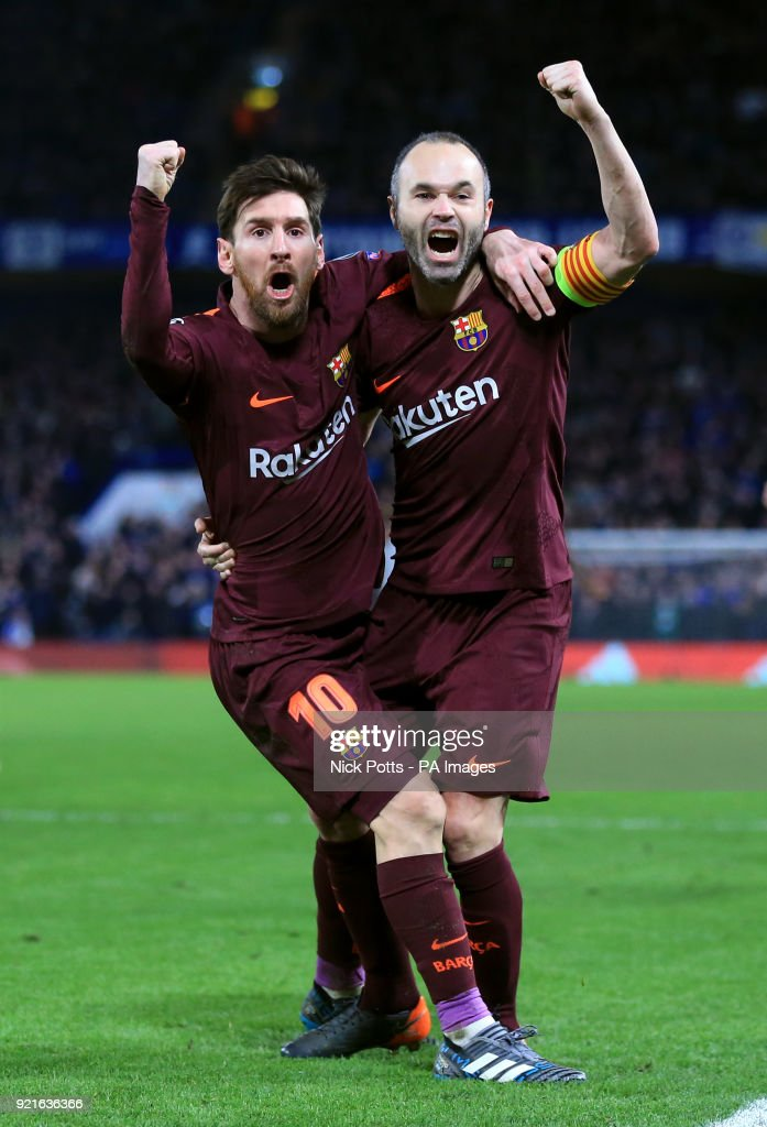 Barcelona's Lionel Messi (left) celebrates scoring his side's first goal of the game with Andres Iniesta during the UEFA Champions League round of sixteen, first leg match at Stamford Bridge, London.