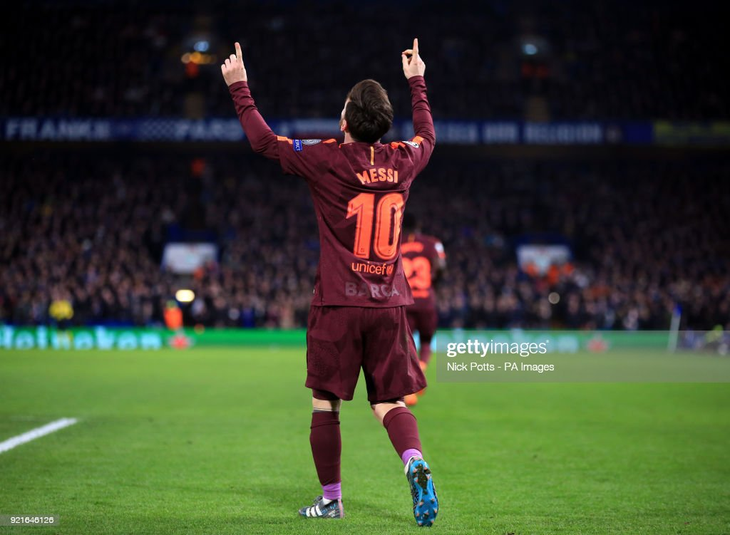 Barcelona's Lionel Messi celebrates scoring his side's first goal of the game during the UEFA Champions League round of sixteen, first leg match at Stamford Bridge, London.