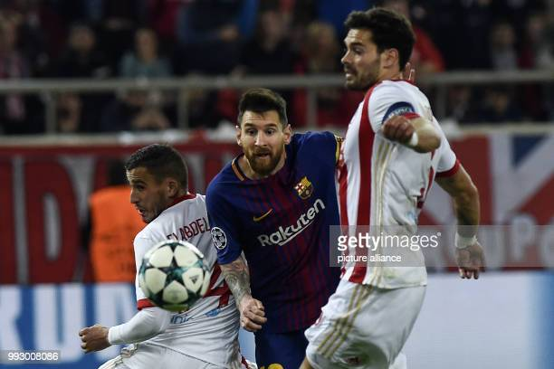 FC Barcelona's Lionel Messi fights for the ball with Olympiacos' FC Alberto Botia during Group D UEFA Champions League football match between...