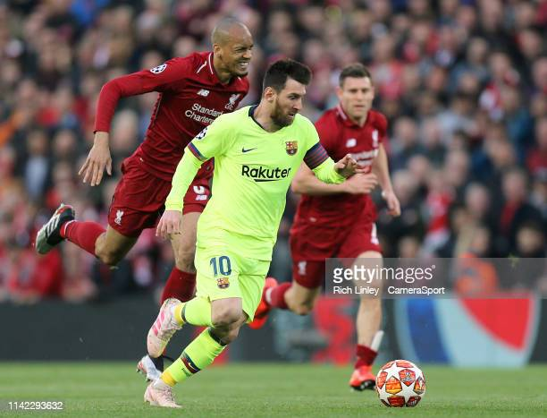 Barcelona's Lionel Messi gets away from Liverpool's Fabinho during the UEFA Champions League Semi Final second leg match between Liverpool and...