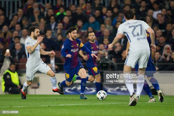 Barcelonas Lionel Messi holds off the challenge from Chelsea's Cesc Fabregas during the UEFA Champions League Round of 16 Second Leg match FC...