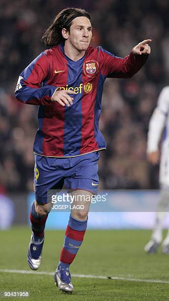 Barcelona's Lionel Messi of Argentina gestures after scoring during a Liga football match against Recreativo at the New Camp in Barcelona 24 November...
