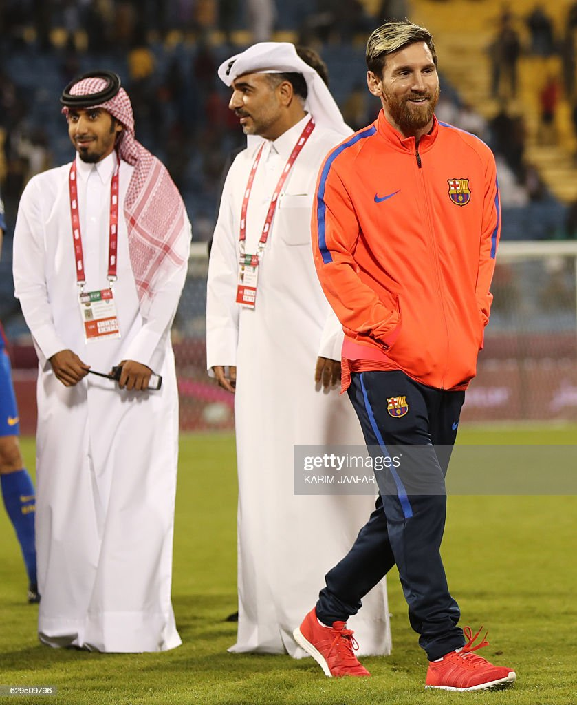 FC Barcelona's Lionel Messi receives smiles following a friendly football match between FC Barcelona and Saudi Arabia's Al-Ahli FC on December 13, 2016 in the Qatari capital Doha. Goals from Luiz Suarez, Lionel Messi and Neymar helped Barcelona beat Saudi champions Al-Ahli 5-3 in a thrilling friendly in Doha. The superstar trio all scored by the 17th minute, helping the Spanish giants to stroll into an early three-goal lead. JAAFAR