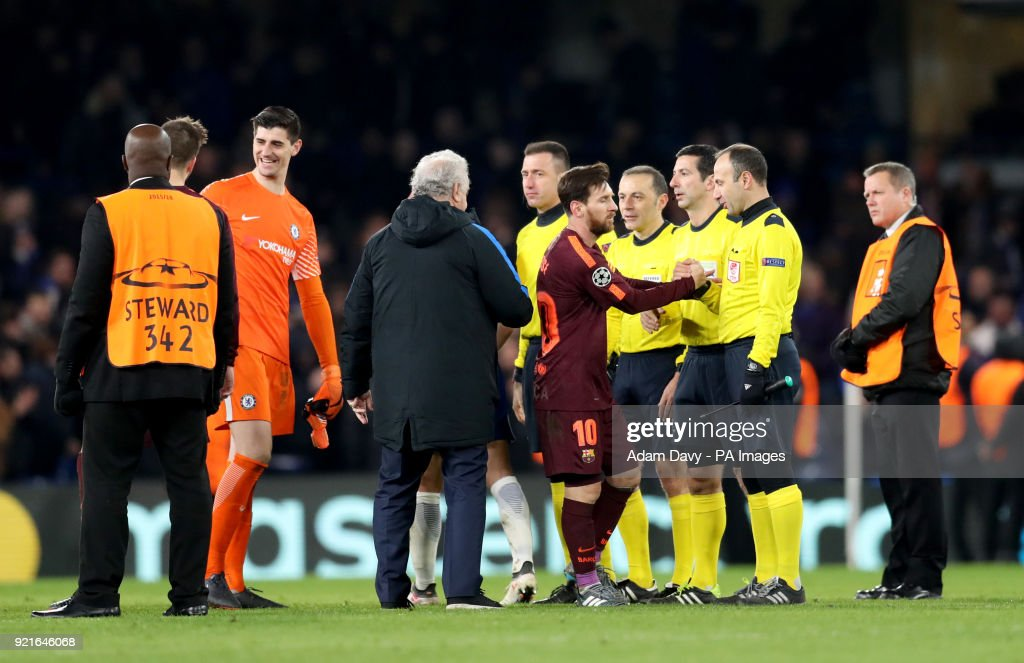Barcelona's Lionel Messi shakes hand with an official after the final whistle during the UEFA Champions League round of sixteen, first leg match at Stamford Bridge, London.