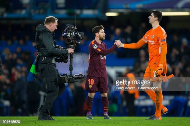 Barcelonas Lionel Messi shakes hands with Chelsea's Thibaut Courtois at full time during the UEFA Champions League Round of 16 First Leg match...