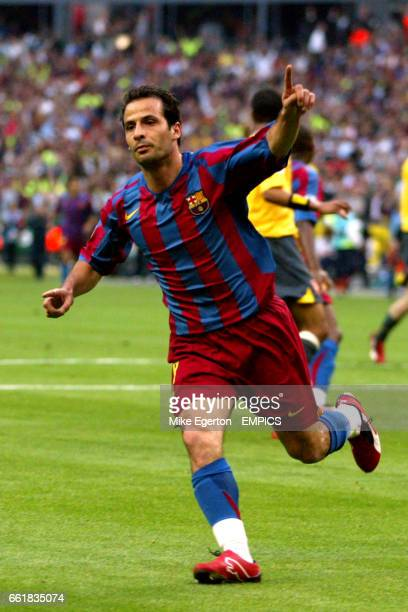 Barcelona's Ludovic Giuly celebrates scoring but his goal was ruled out after Arsenal goalkeeper Jens Lehmann pulled down Barcelona's Samuel Eto'o