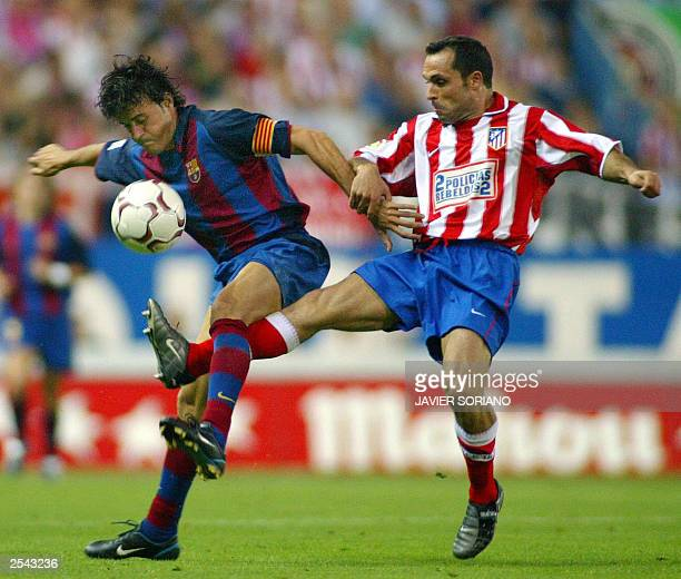 Barcelona's Luis Enrique vies with Atletico de Madrid's Sergi Barjuan during their Spanish League match between Atletico de Madrid and Barcelona at...