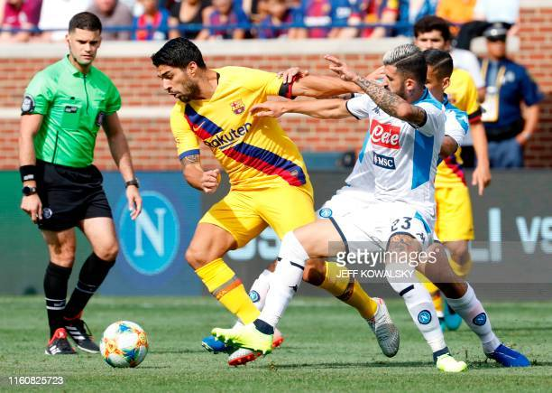 Barcelona's Luis Suarez is defended by SSC Napoli's Elseid Hysaj during the first half in their La Liga-Serie A Cup match on August 10, 2019 at...