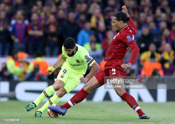 Barcelona's Luis Suarez is tackled by Liverpool's Virgil van Dijk during the UEFA Champions League Semi Final second leg match between Liverpool and...